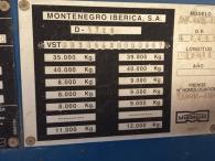 Bañera basculante marca Montenegro, de 3 ejes de ballesta, el primero elevable. año 2003