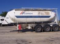Cisterna para cemento de aluminio marca Hermans, con llantas de aluminio, frenos de disco, suspensión neumática, capacidad 31m3, del año 2000.